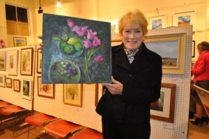 Denise Charlton and her Painitng titled 'The Pink Tulips'